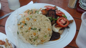 Tilapia, shito and fried rice at Bojo Beach Resort, Accra, Ghana