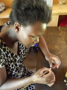Carefully painting each ceramic bead
