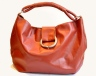 Round Red Mela Handbag with Bracelet from Danaqa is burnt orange enough for me